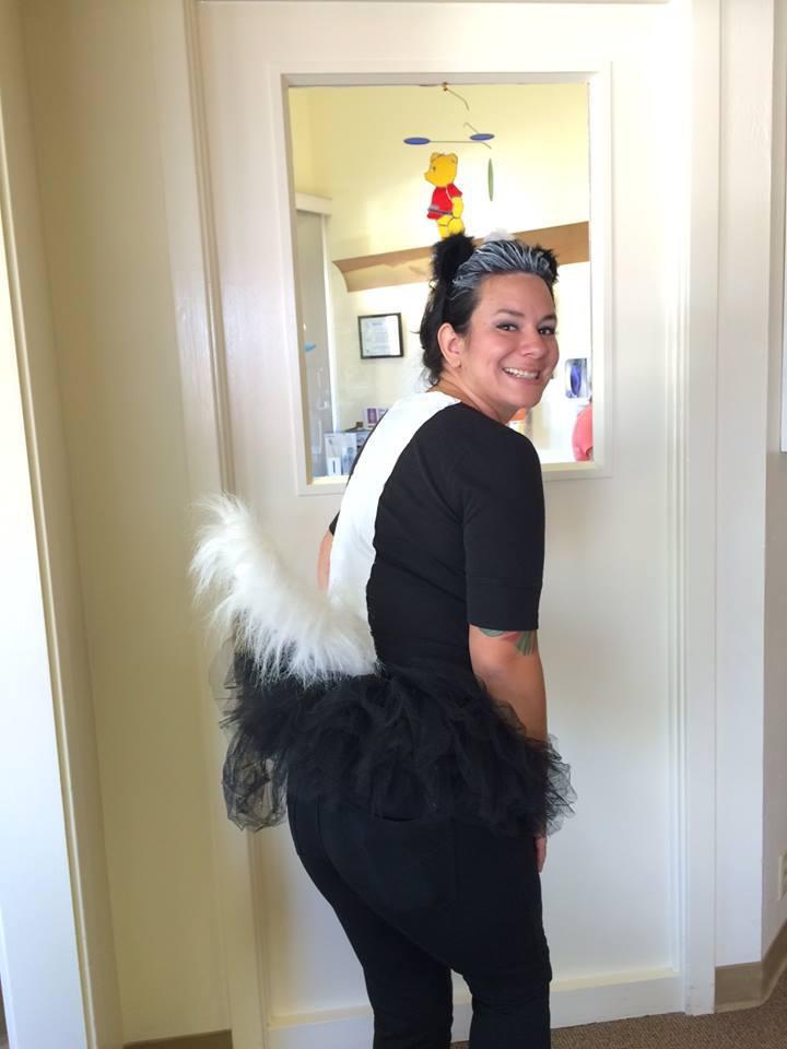 Woman in skunk costume