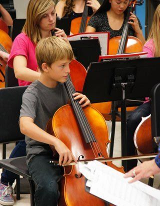 Young boy playing cello