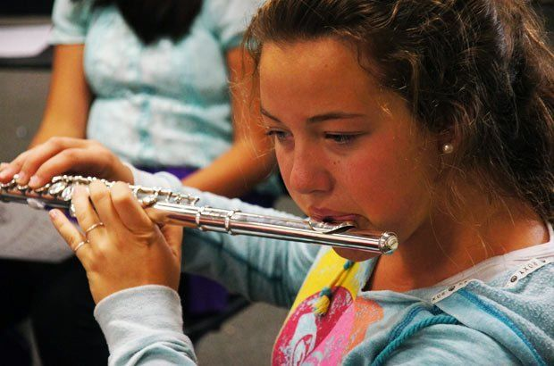 Young girl playing the flute